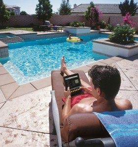 Pool Automation Example Man By Pool With iPad