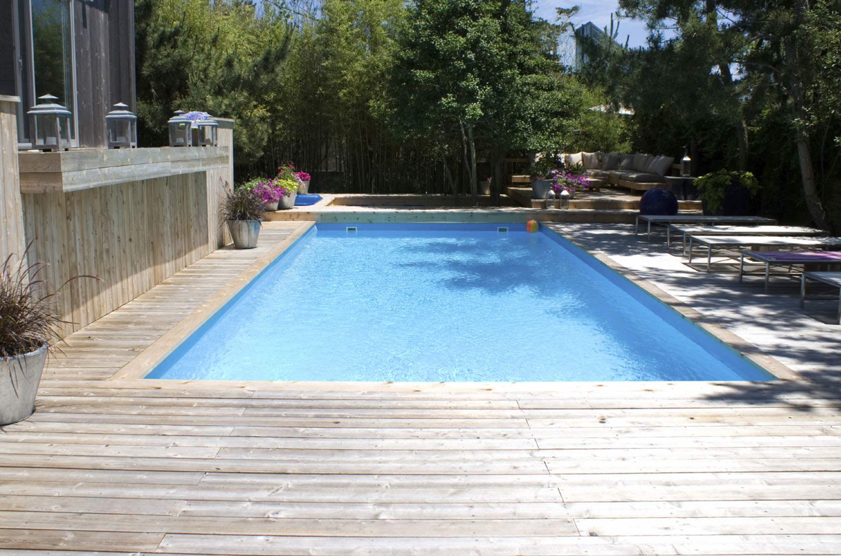 Pool deck wood example reston virginia pool design for Pool design examples